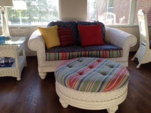 Picture of couch and ottoman in the sunroom
